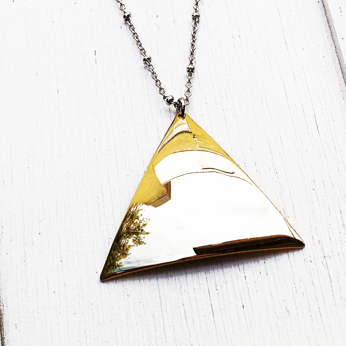 Long hanging reflective metal triangle pendant