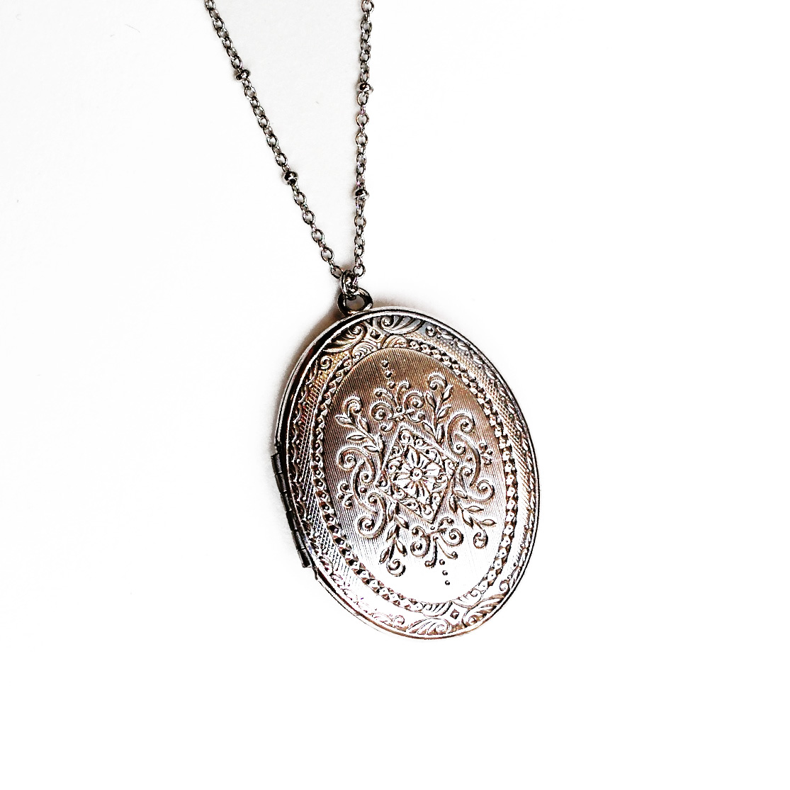 Locket with embossed details