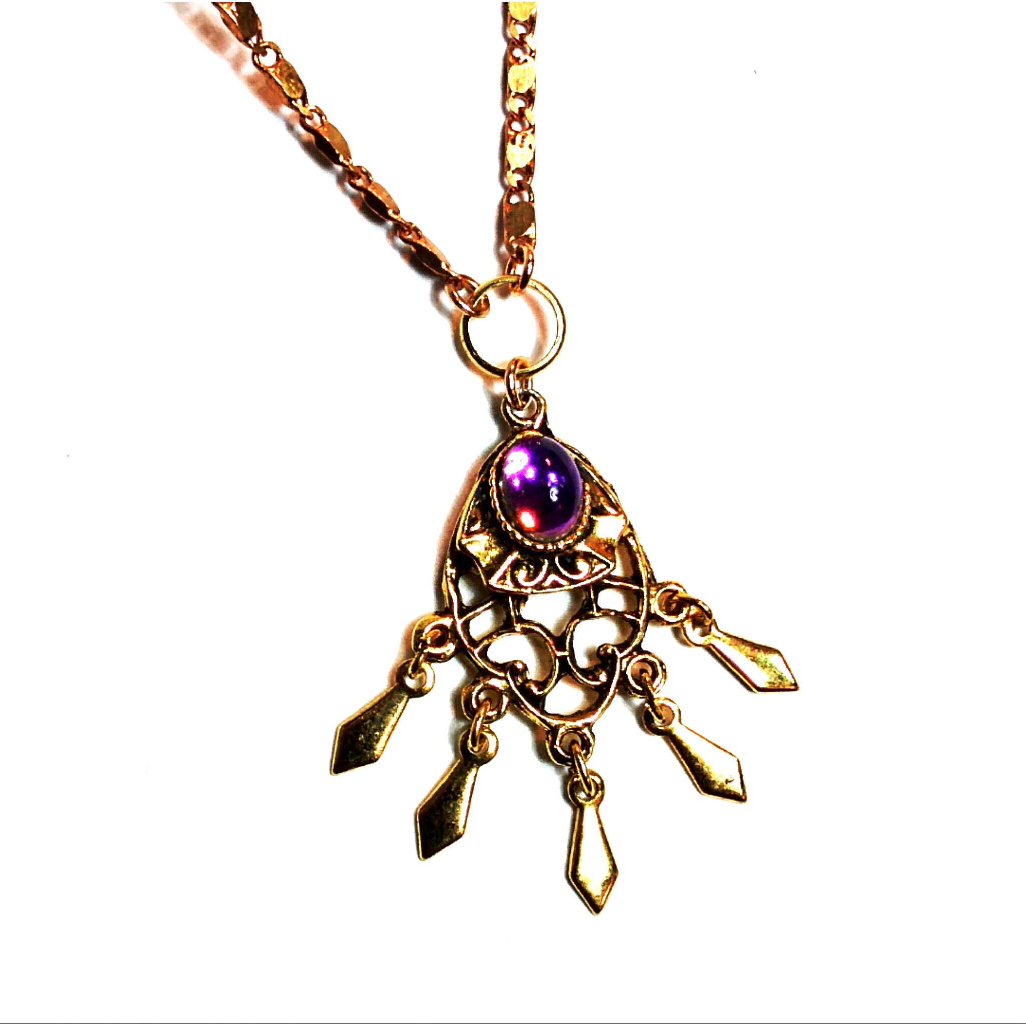 Beautiful vintage pendant with purple stone and fringe