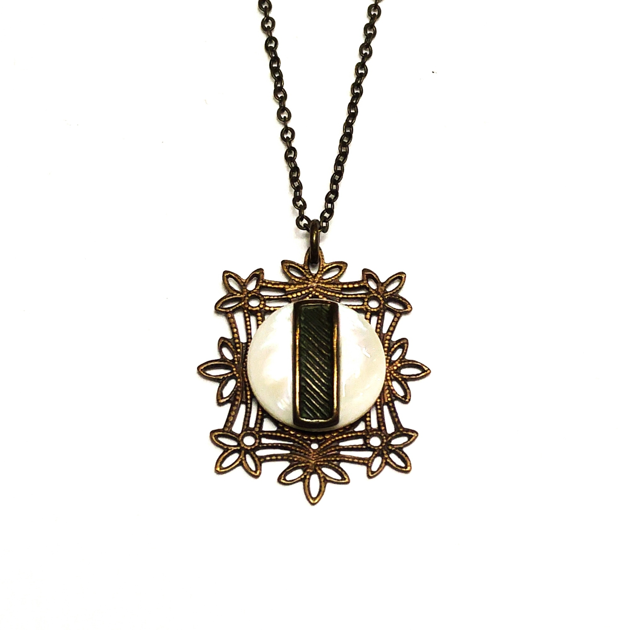 Unique pendant with plenty of lovely small details and a mother of pearl centre