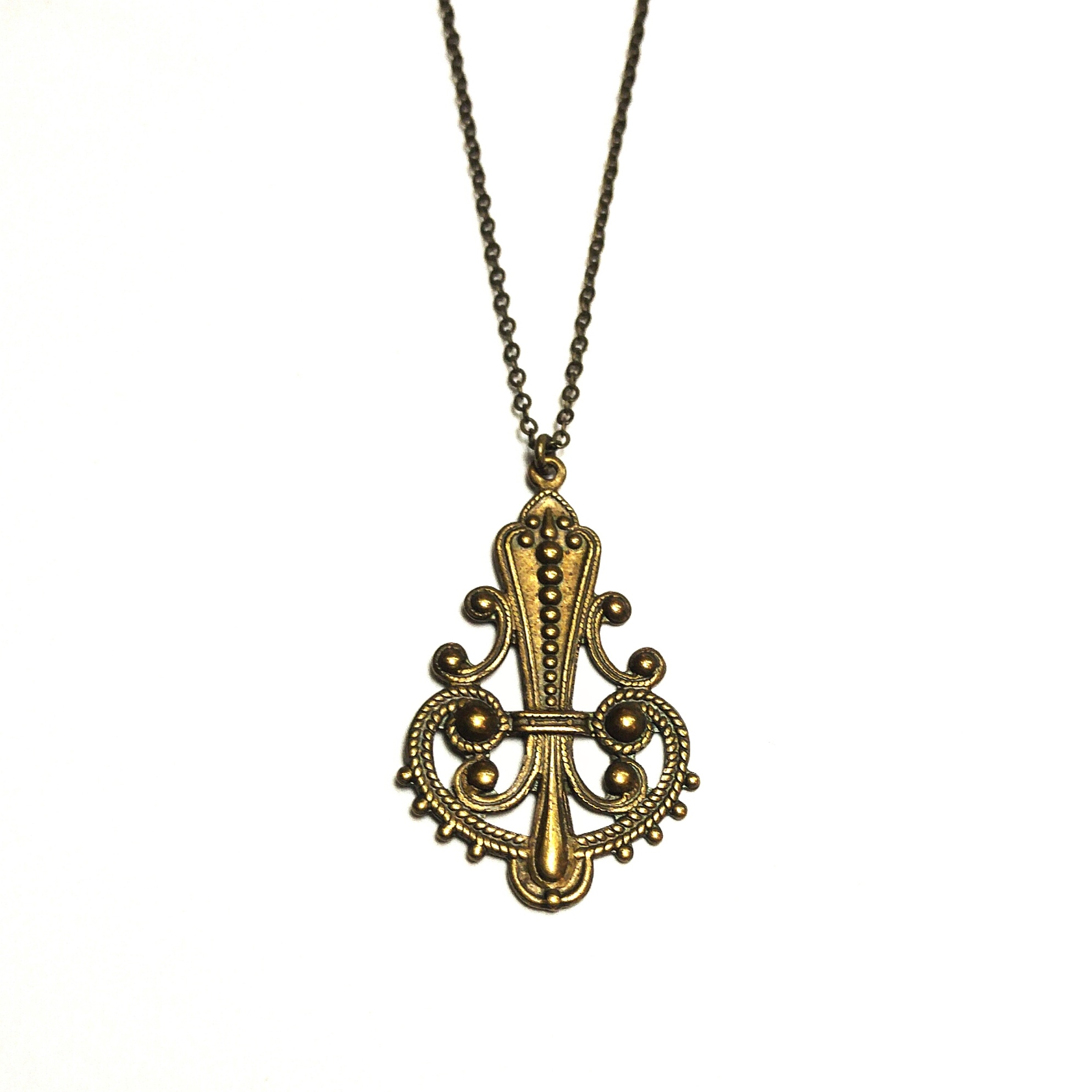 Detailed brass pendant