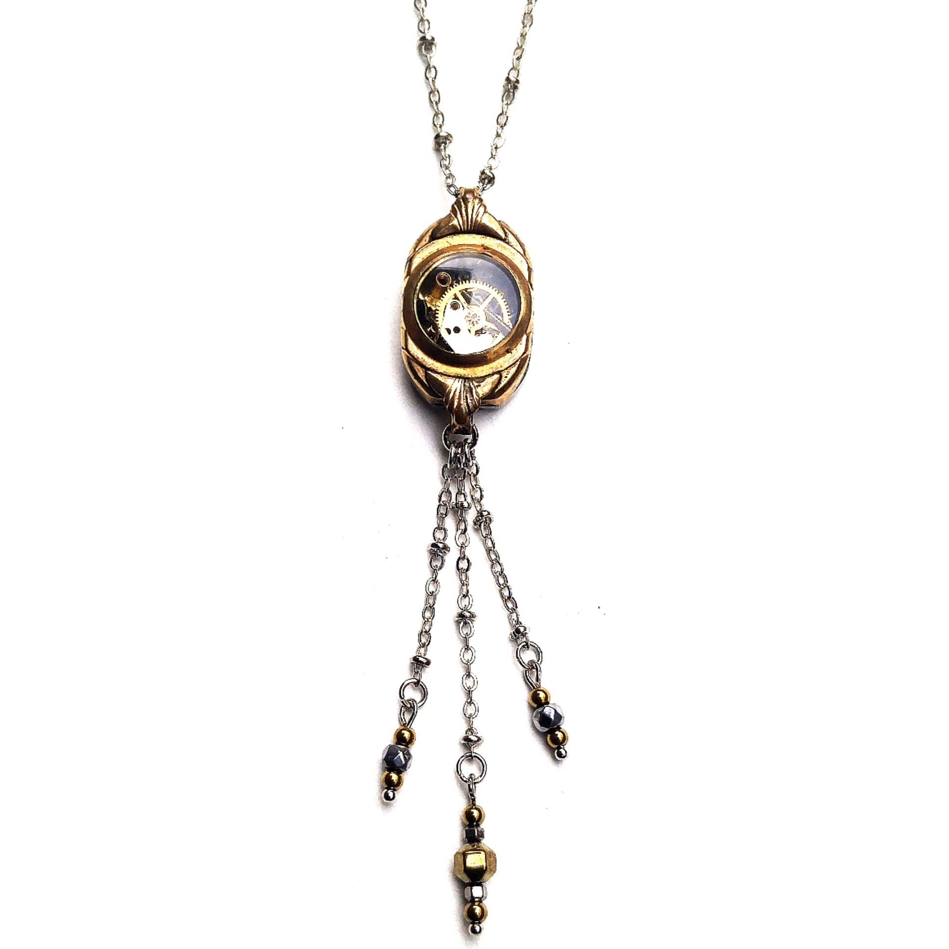 watch case with floating watch parts and beaded Hematite details.