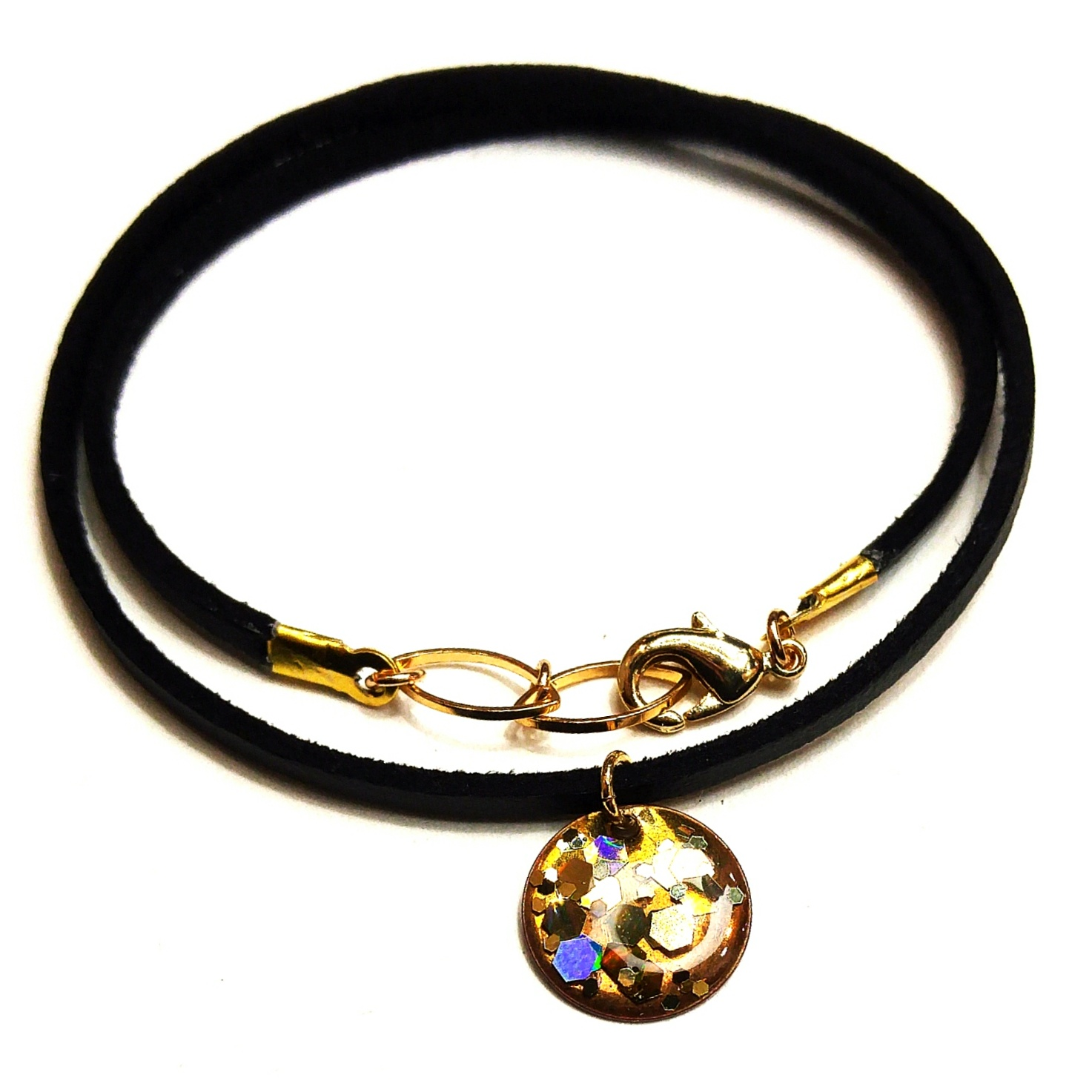 upcycled brass piece taken from a vintage belt has been adorned with some high end sparkles, set in resin