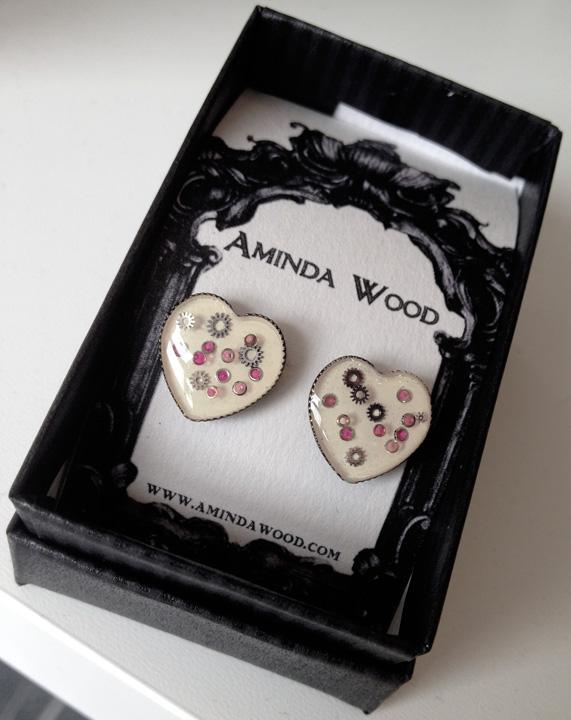 aminda-wood-white-mechanical-heart-earrings.jpg