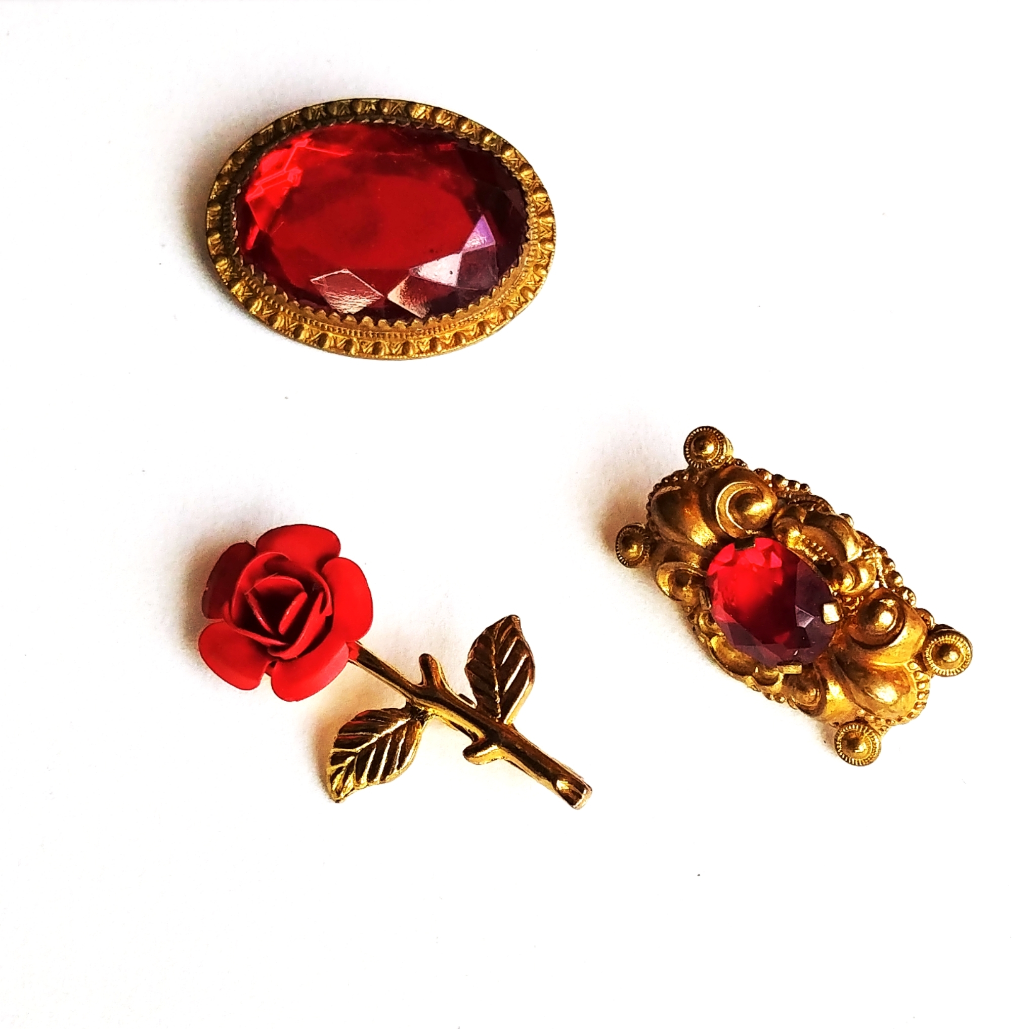Red themed vintage brooches