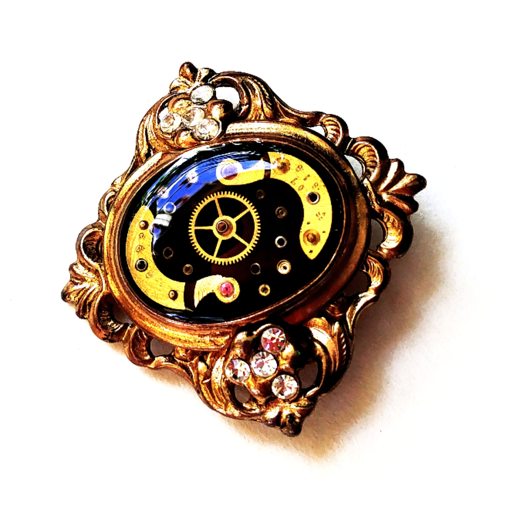 """Multiple layers of antique watch parts set in place of the stone I removed from an upcycled brooch! A unique one of a kind piece - roughly 2 1/4"""" wide."""