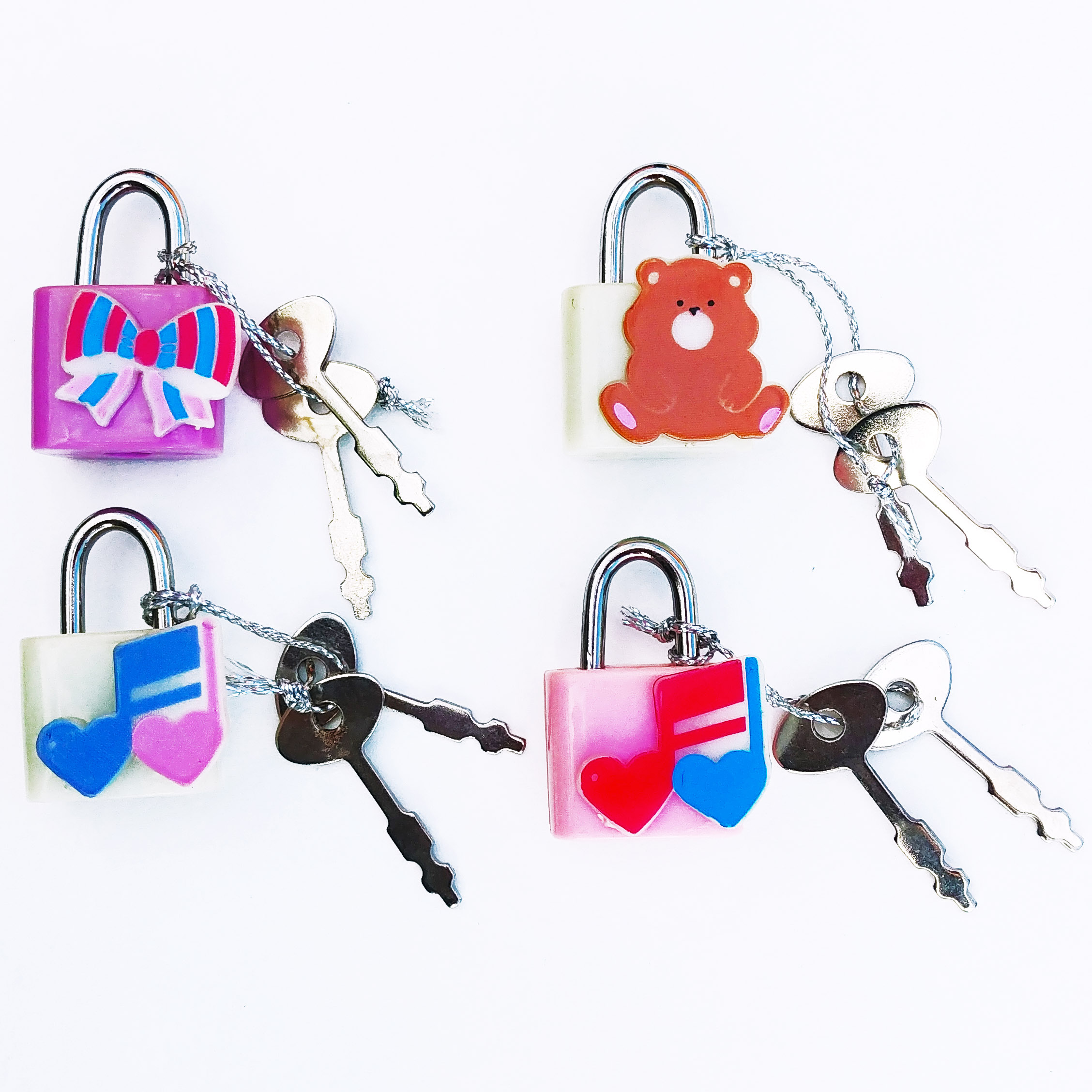 Very cute set 90's locks with key available at the Leslieville Arts Market