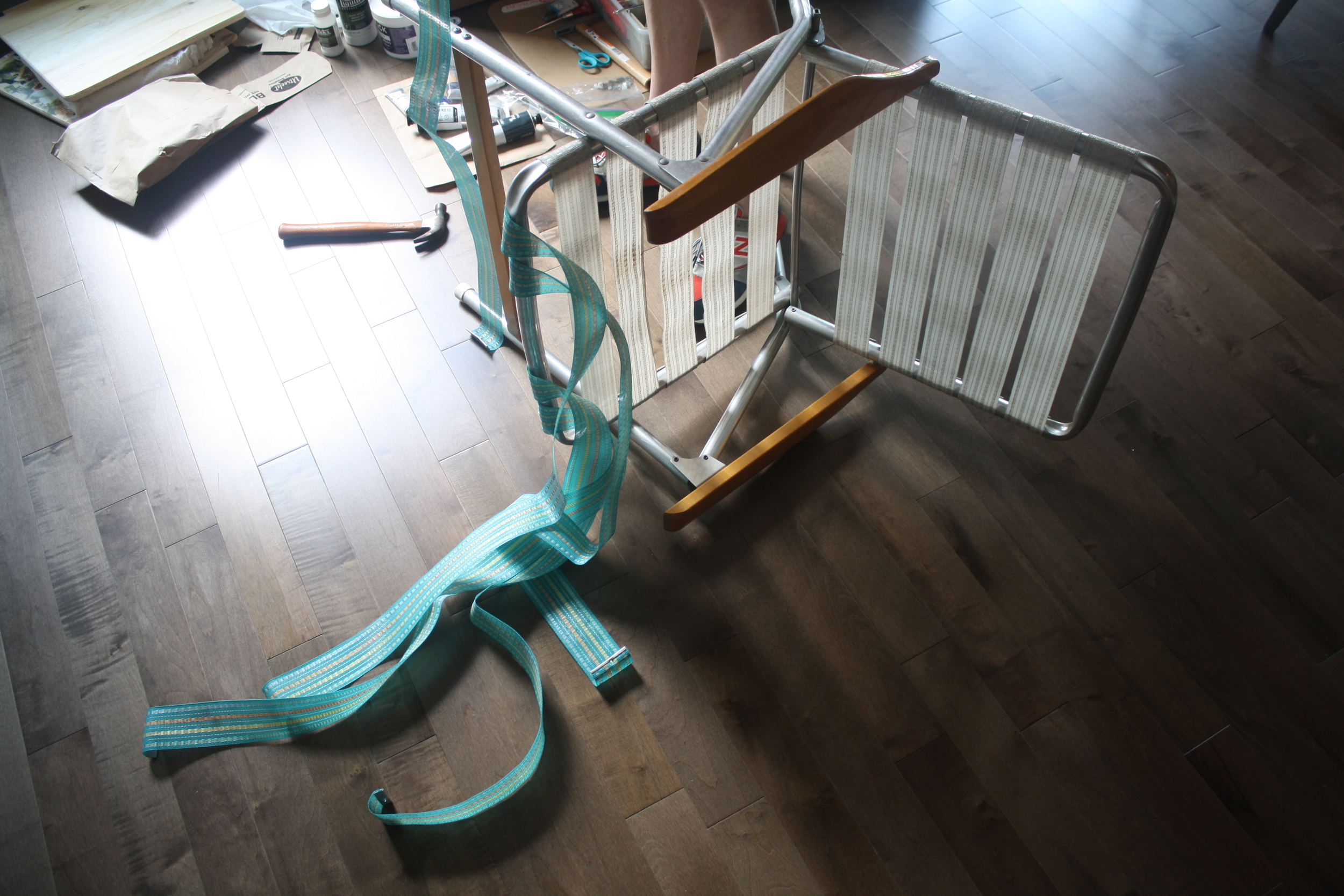 First step is to disassemble the chair by unscrewing the canvas strips. Discard all but one from each direction to use as a template.