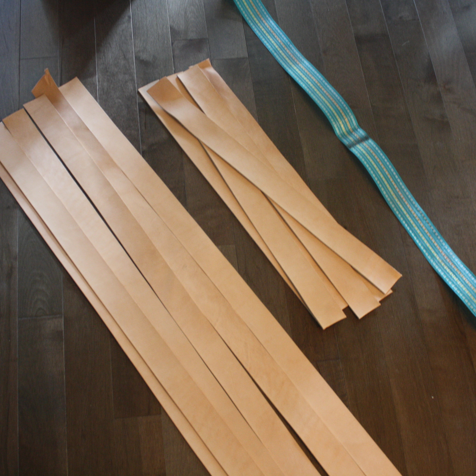 Using a strip as a template, cut your leather strips - give an inch of extra room just in case.