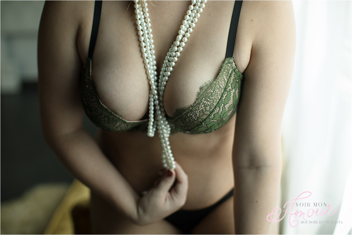 Breasts with pearls.
