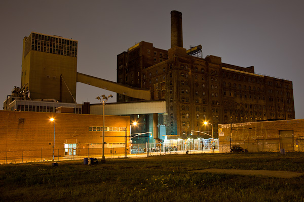 Domino factory from the Brooklyn side. Notice the crouching photographer in the street. He is the little black dot under the smokestack in the street lights. This picture was used for The L Magazine cover shot. ©2010 harlan erskine