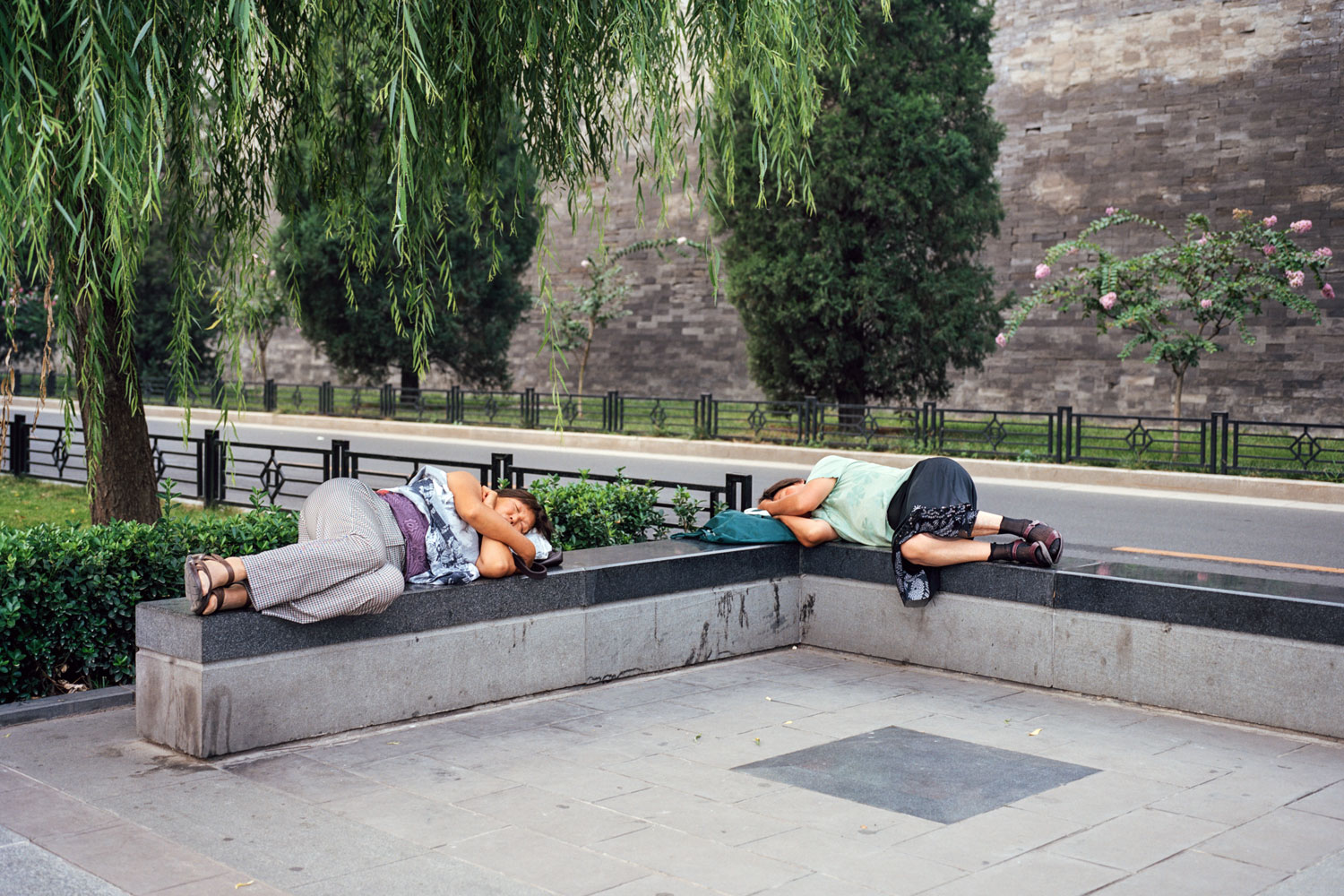 Napping outside the Forbidden City