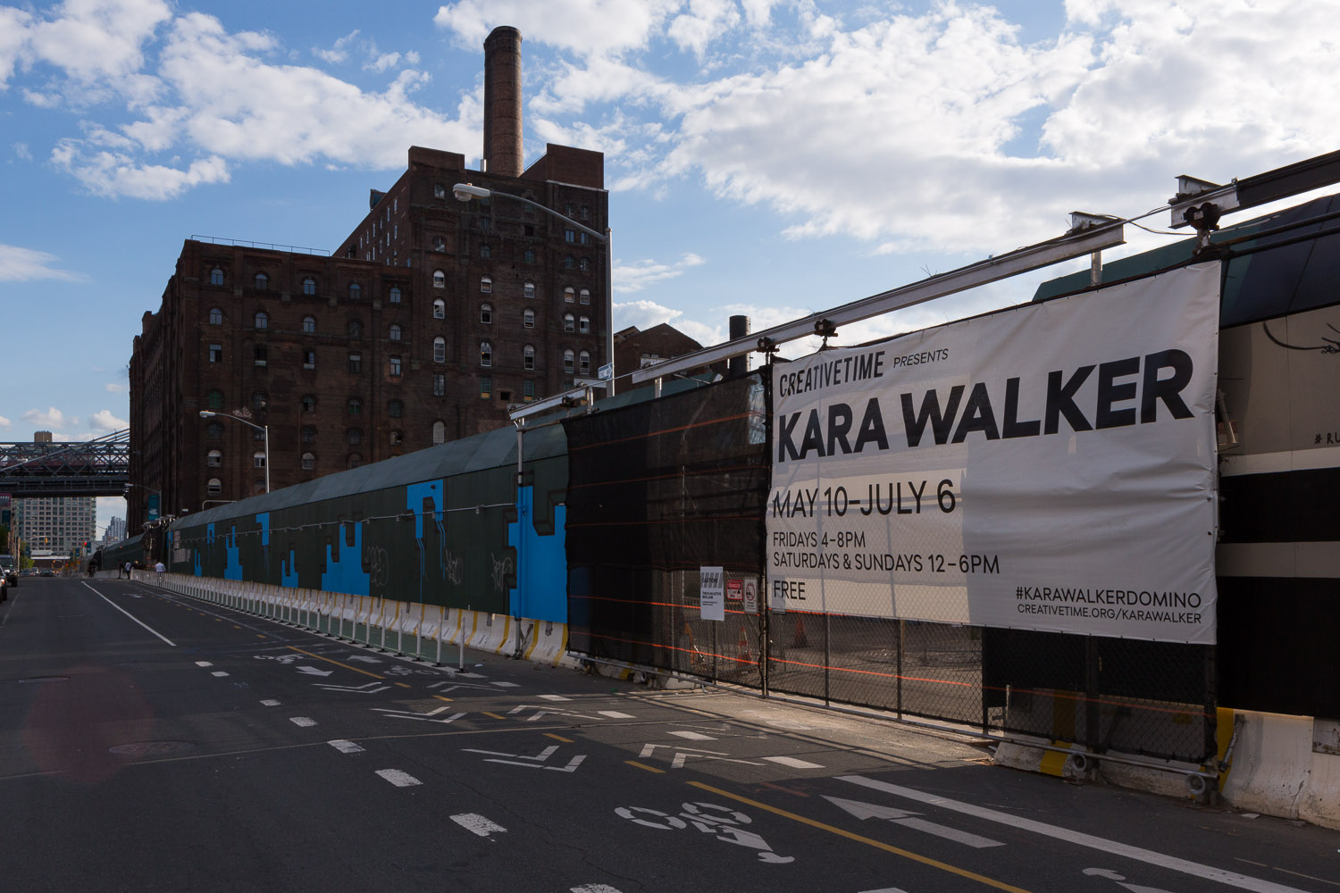 The entrance to Kara Walker on Kent Avenue with Domino Sugar Factory sitting beyond the gate.