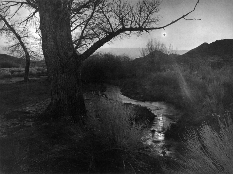 """Ansel Adams, """"The Black Sun, Owens Valley, California,"""" 1939 From the book """" Examples: The Making of 40 Photographs ,"""" page 124."""