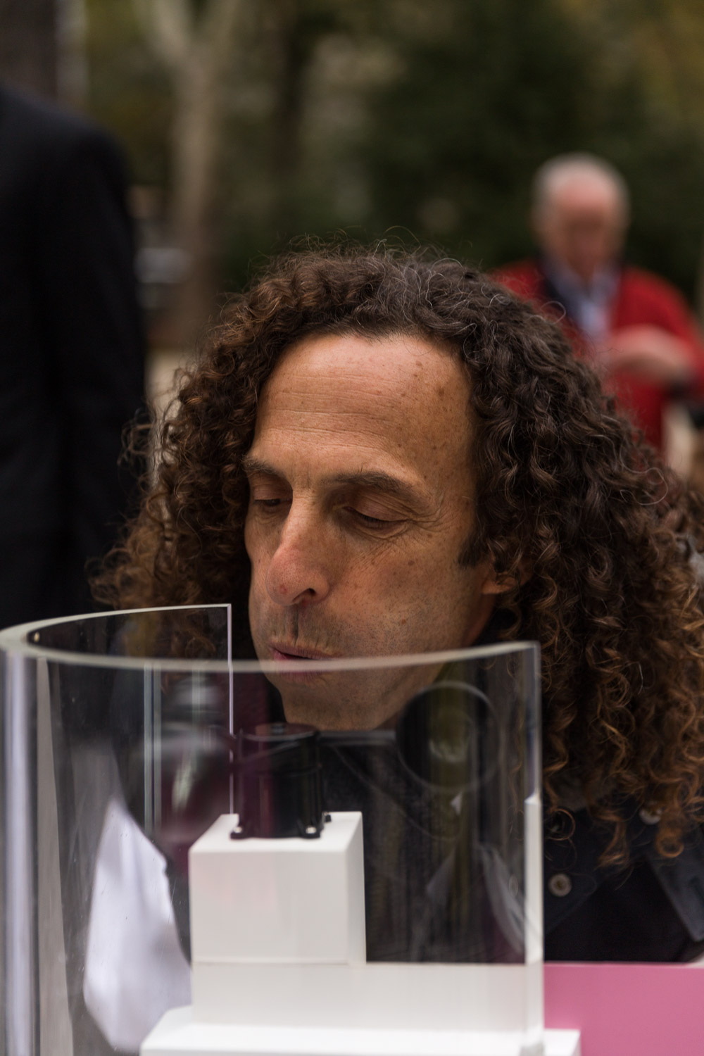Kenny G happened to be in the park. Here he works some circular breathing wind energy technique.