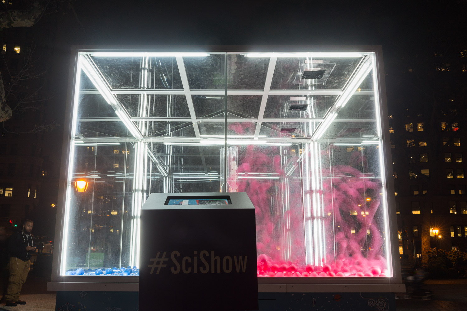 YouTube/ SciShow energy demonstration illuminates the night. The #SciShow box displays info about the event.