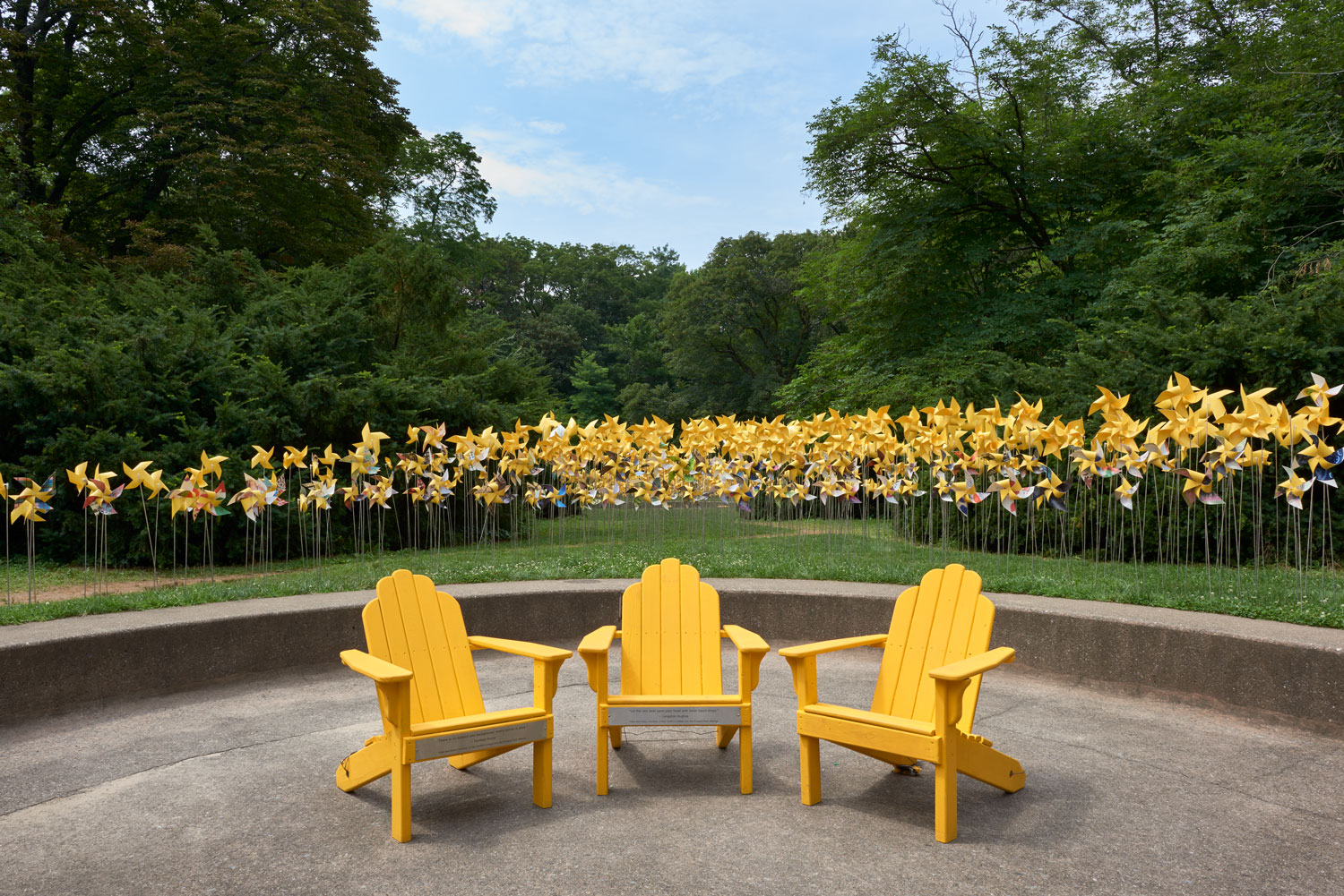 Three Adirondack chairs at the Connective Project in Prospect Park, Brooklyn. Image © harlan erskine