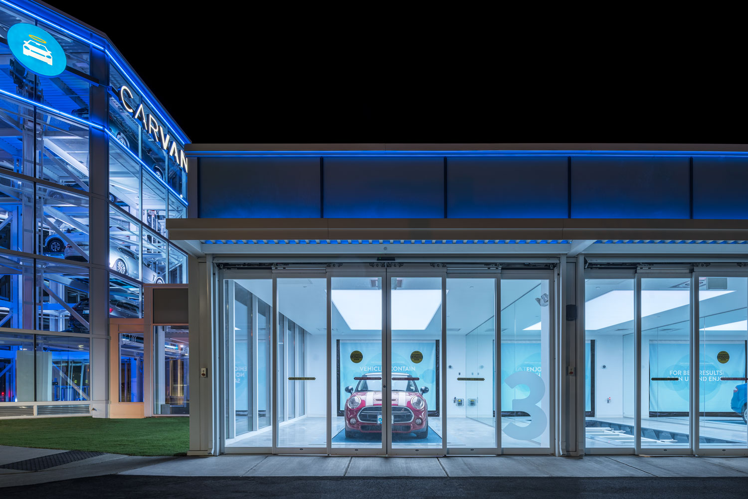CARVANA, with a MINI Cooper S in bay 3 and their car vending machine off to the left, Raleigh, NC © harlan erskine.