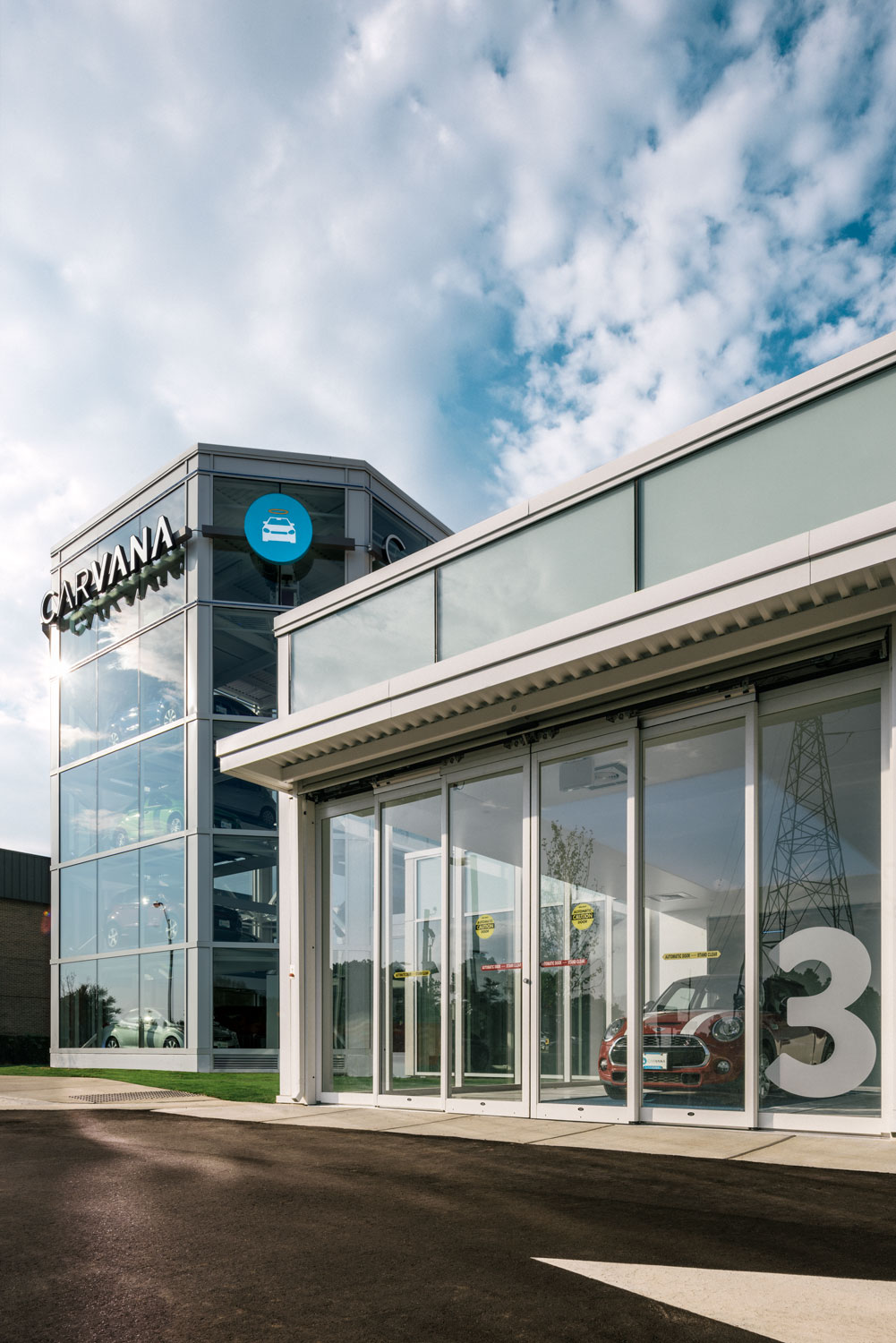 CARVANA, with a MINI Cooper S in bay 3 and their car vending machine on the left, Raleigh, NC © harlan erskine.