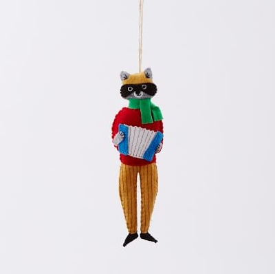 This Christmas ornament, of a raccoon playing an accordion, is especially charming. From West Elm  USD$14