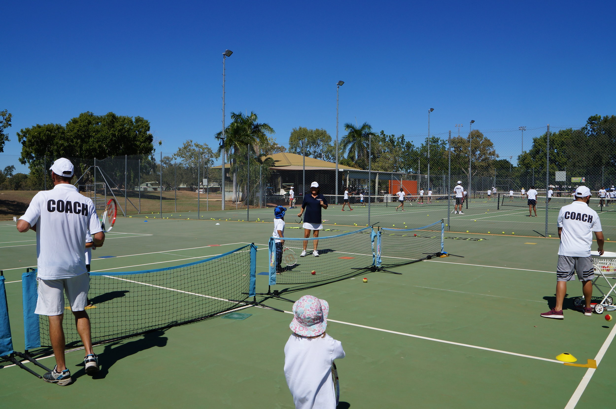 All coaches on deck and working hard at Katherine Tennis Club