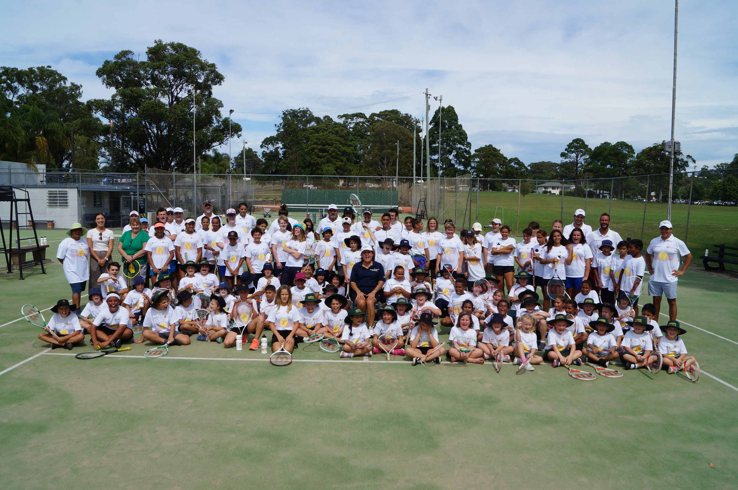 A family snap of another 100 + in Coffs – Thank you Jarred Kelly and TieBreak Tennis Academy  for hosting us at the Coffs Harbour Tennis Club