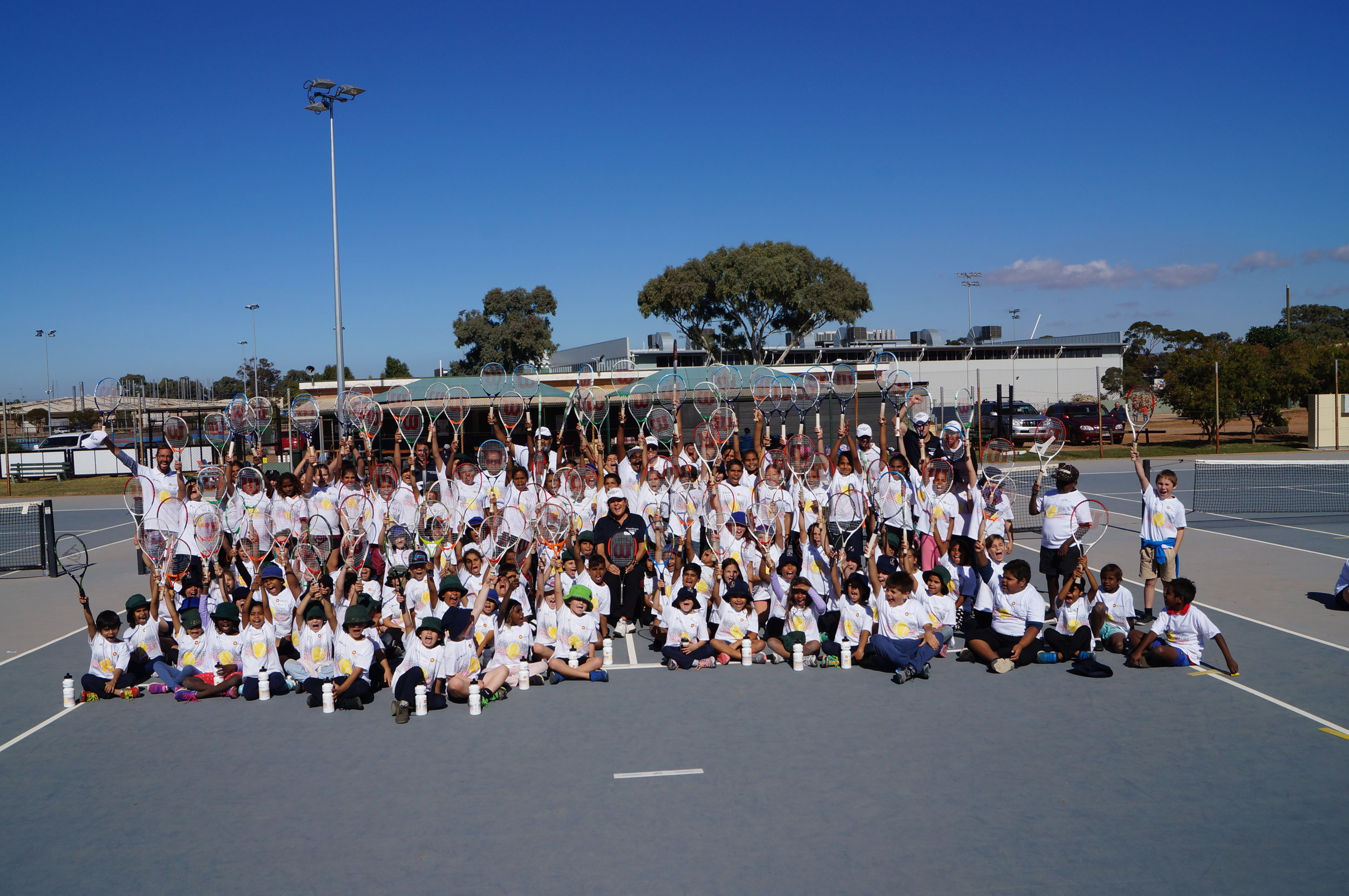 Too many arms to count here! EGF staff join Evonne and 113 locals for the group shot