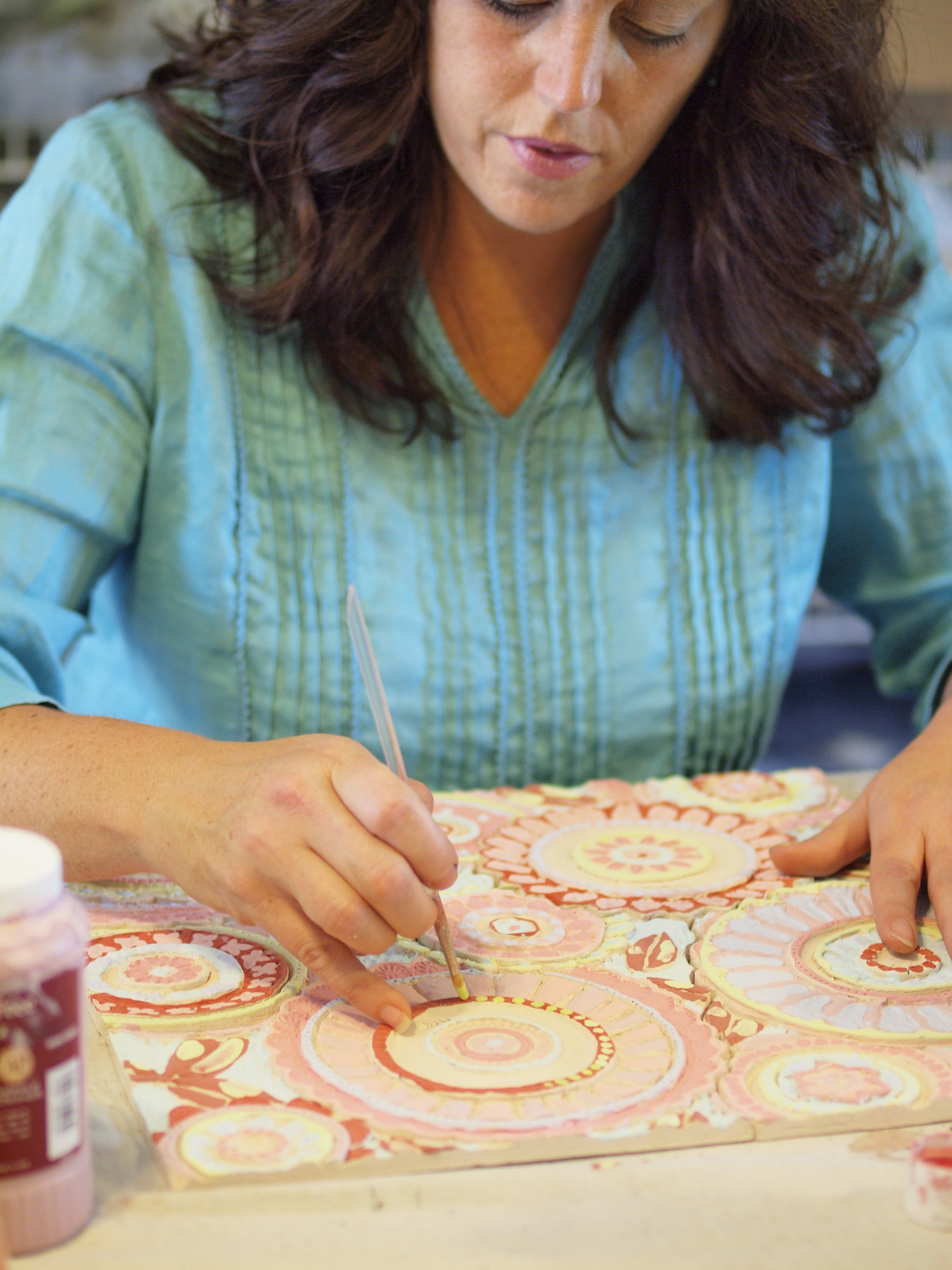 Romy painting on the several layers of glaze.