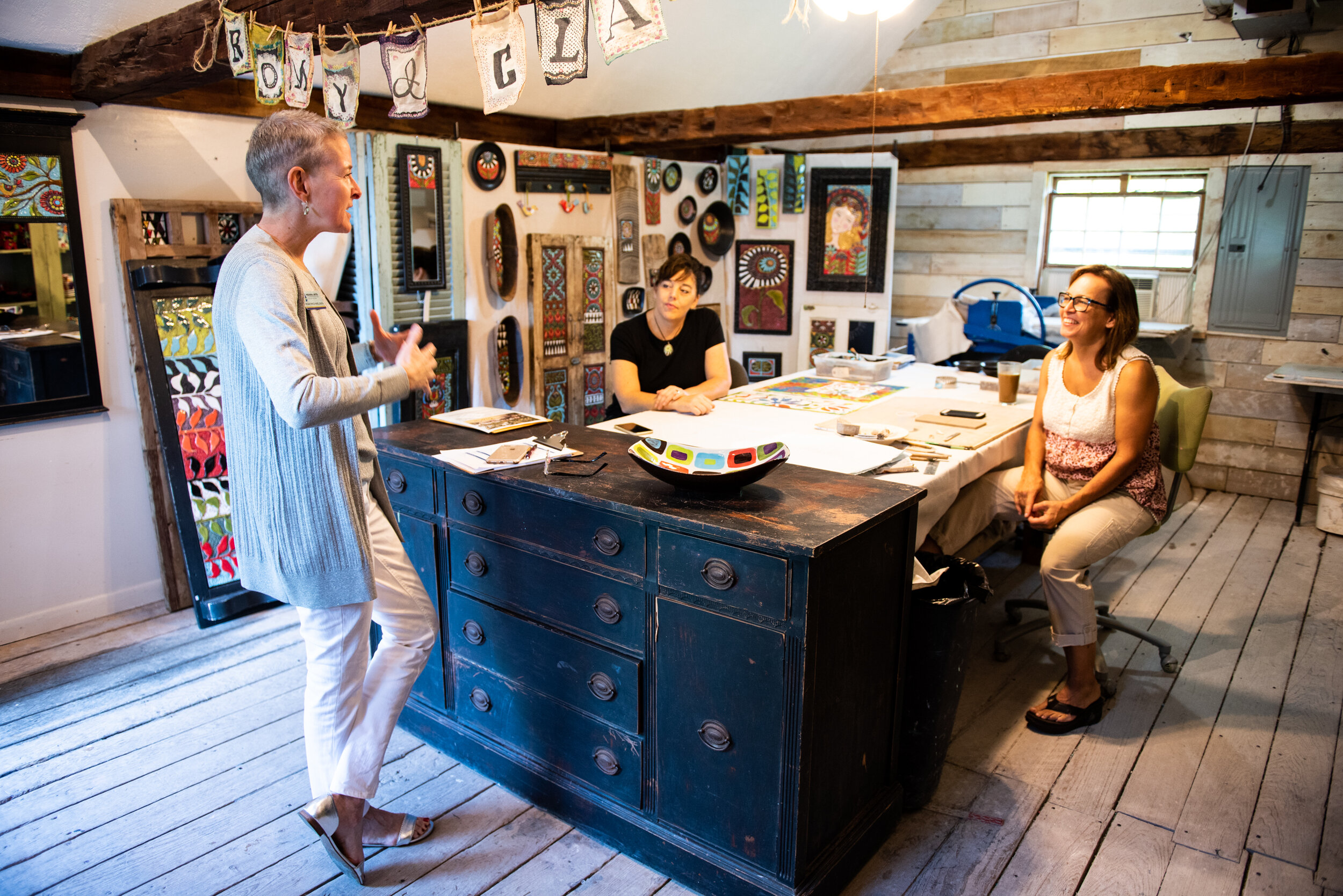 Indiana Arts Commission's Deputy Director of Operations, Miah Michaelson visits with Romy and Clare in their Japer, Indiana studio.