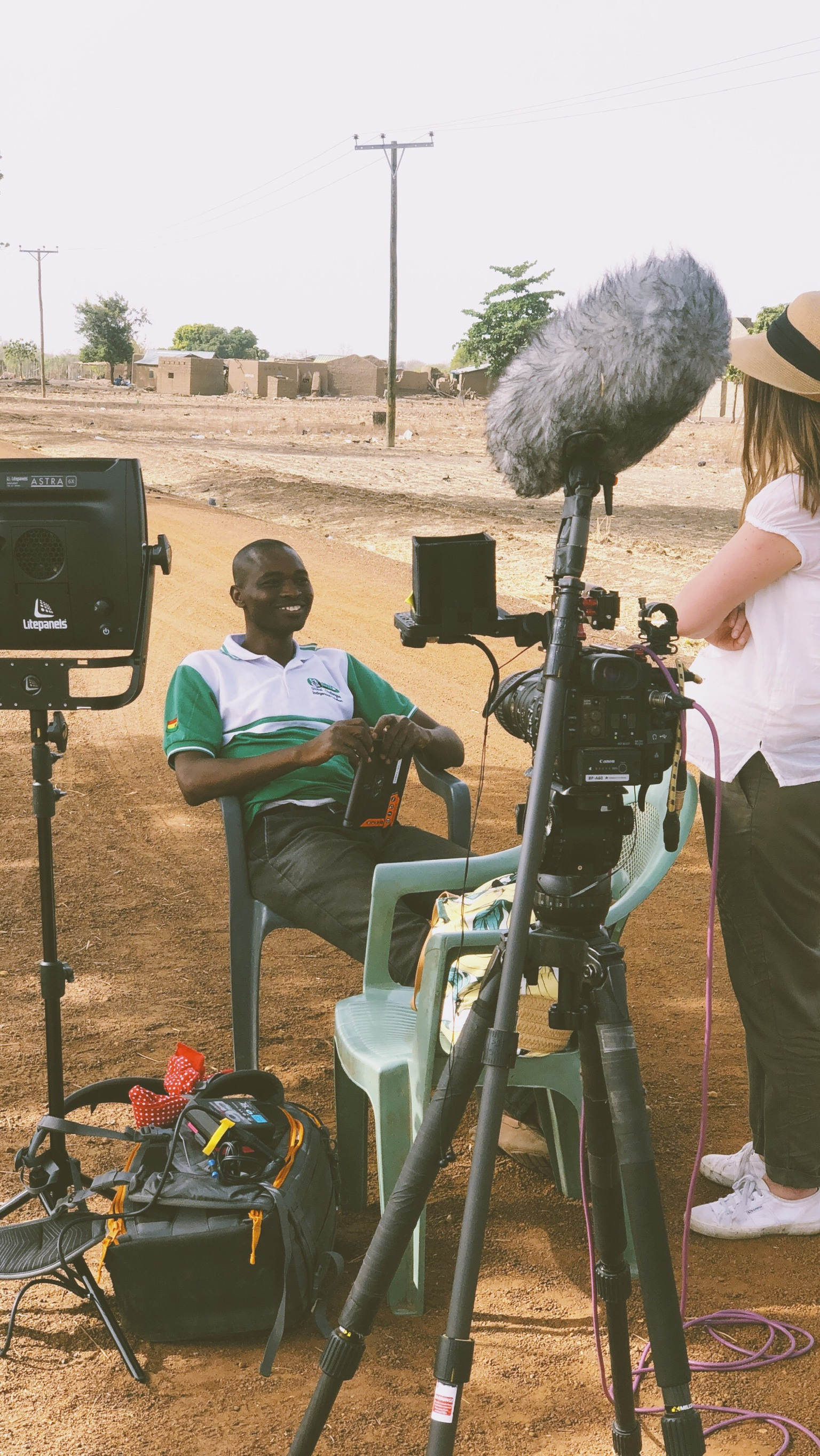 Setting up outside the Kayelo Community in Ghana. Canon C200 with the CN-E 18-80 lens and Litepanels Astra 6X Daylight.