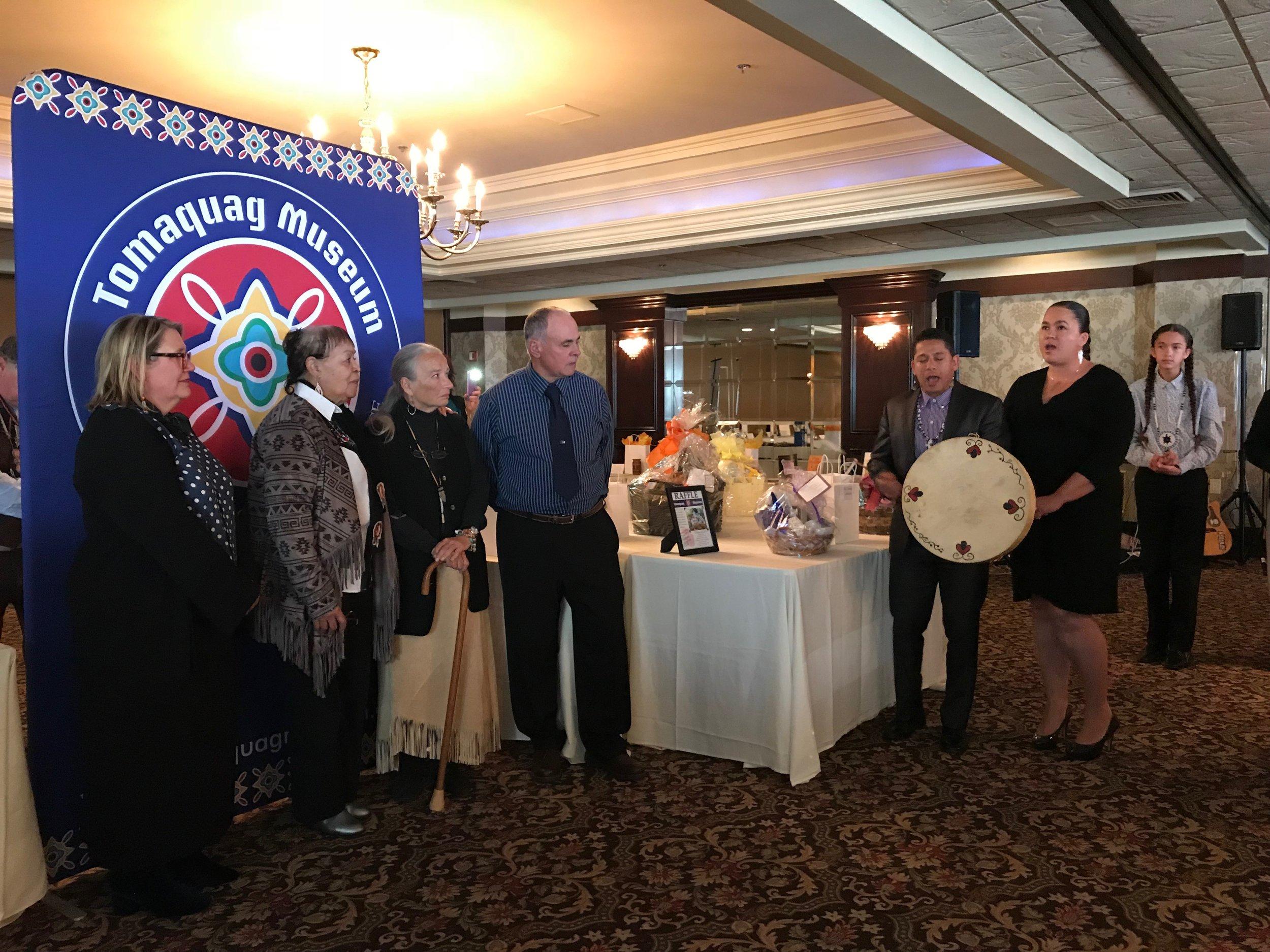 Awardees receiving an honor song by community members Thawn & Eleanor Harris