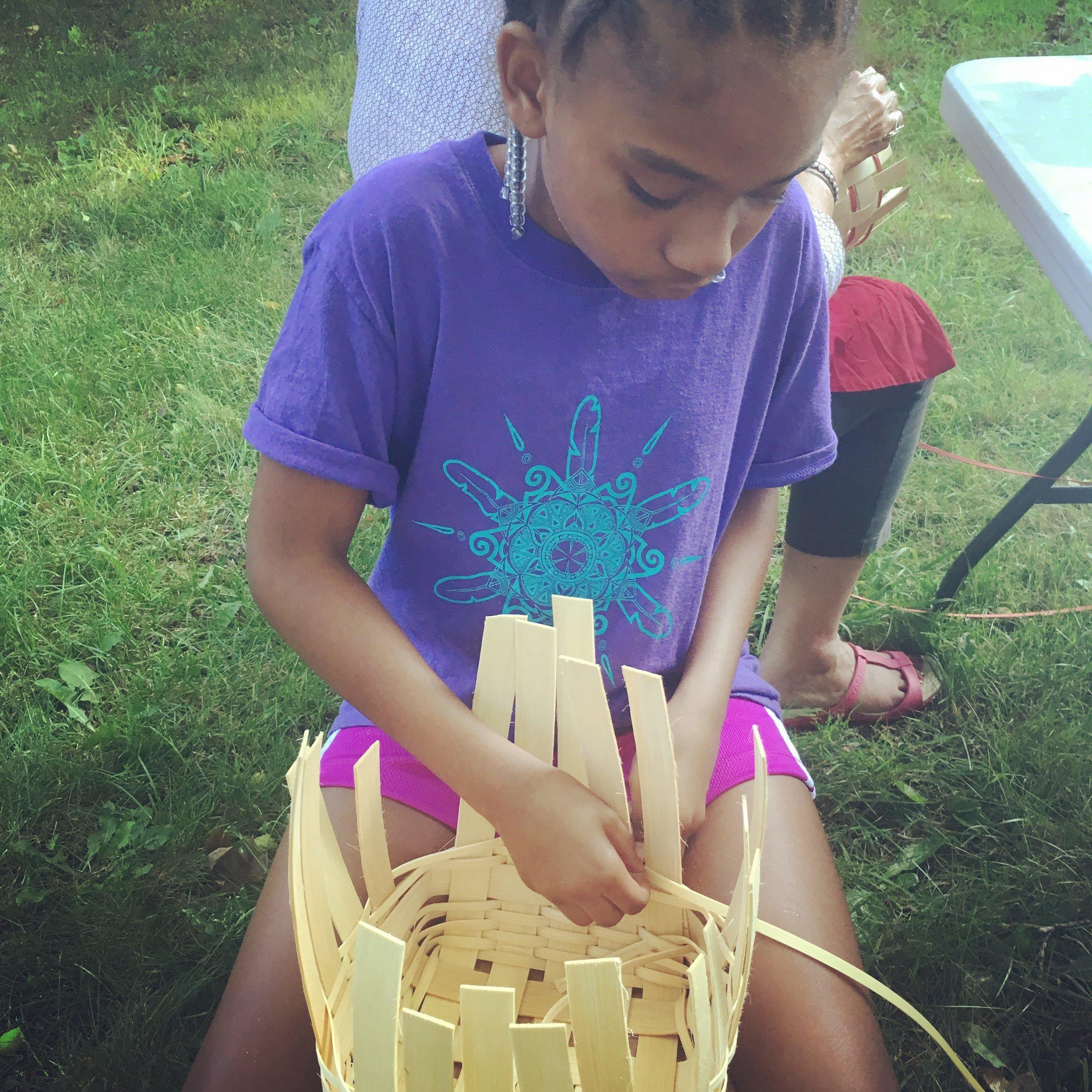 Skyla Jennings, Narragansett, learning to make a basket during Arts & Wellness Class