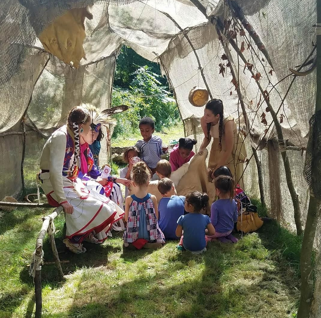 Tomaquag Educator Lynsea Montanari with a group of children during a storytelling program at Tomaquag Museum.