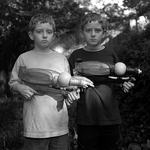 Dylan and Evan with water guns (2005)