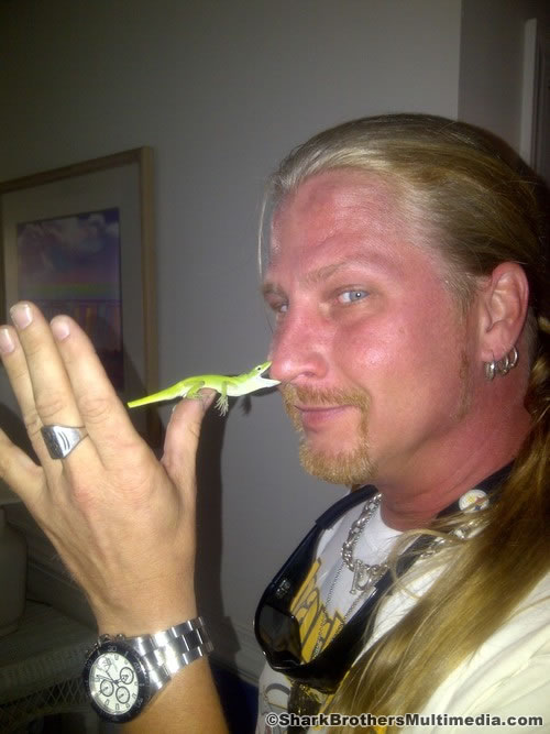 Click for Larger Image. My brother, Brooks, with a green anole while on assignment in Beaufort, NC in 2013. the invasive brown anole has NOT YET dominated less temperate climates north of Florida.