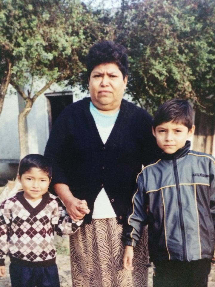 Antonio's little brother, grandmother, and Antonio (far right) as a child in Mexico.