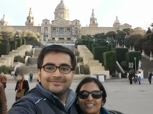 Avinash & Meghana in front of a large building