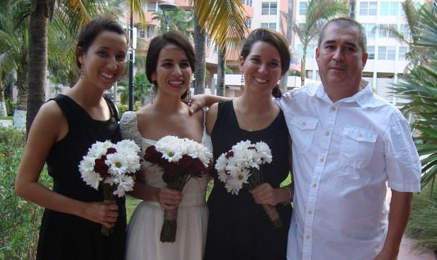 Evelyn with her sisters and father