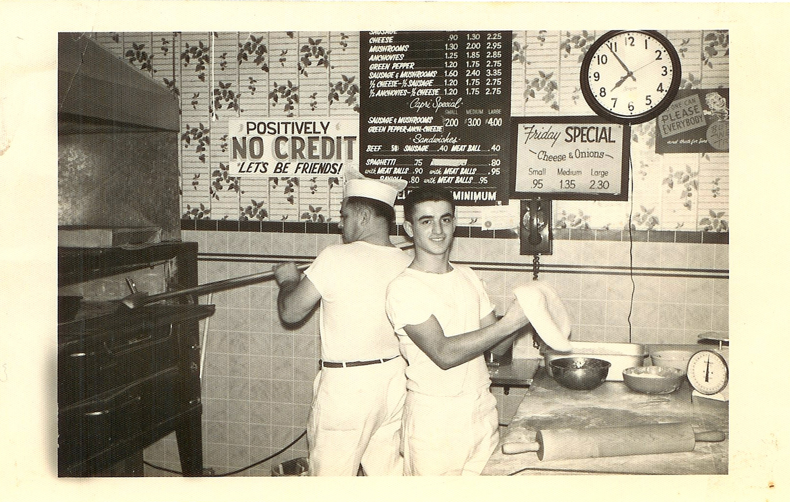Tony Ciannamea (left) and an employee preparing pies during the early days.