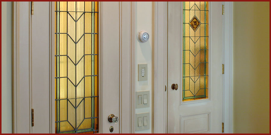 Curated imported stained glass panels creating entry door