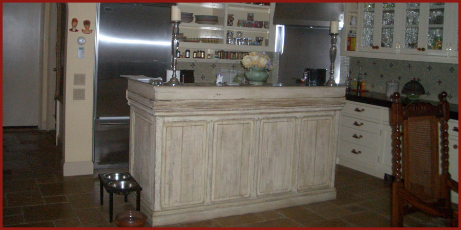 Old brown wood bar transformed into a decorative painted kitchen island