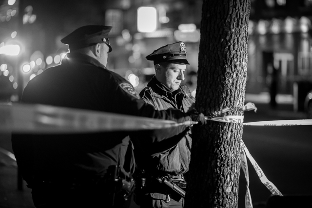 NYPD officers tie off the scene at 90-20 Sutphin Blvd. in Jamaica after the discovery of the bodies of two children and a woman. CREDIT: Ken Maldonado January 19th, 2014