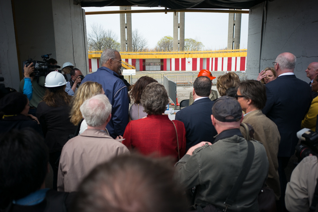 Local officials and members of the media walk in to the New York State Pavilion as its gates are officially opened. April 22nd, 2014