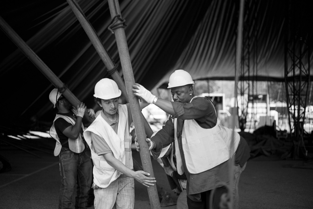 "A crew of over twenty workers called the ""Tent Crew"" place steal beams along the outer edge of the tent. When completed the tent will seat approximately 1,700 spectators."