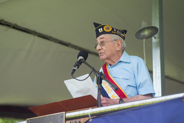 Dr. David Copell, the Grand Marshall of the 2014 Whitestone Memorial Day Parade speaks to the crowd before the start of the parade.