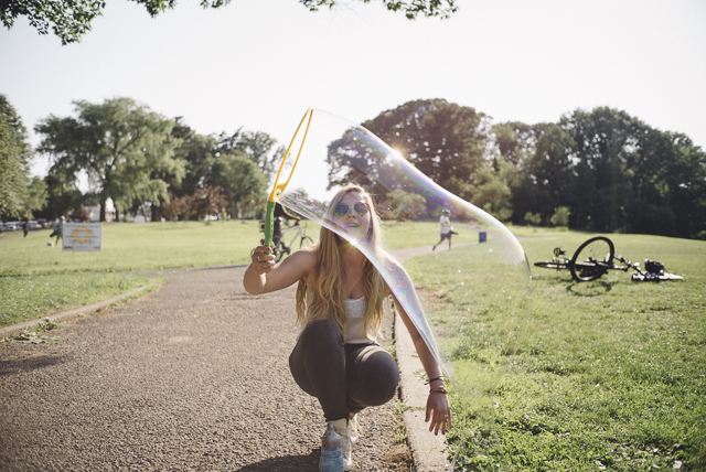 Julia Blenzig, 14, plays with bubbles during a concert held at Crocheron Park.