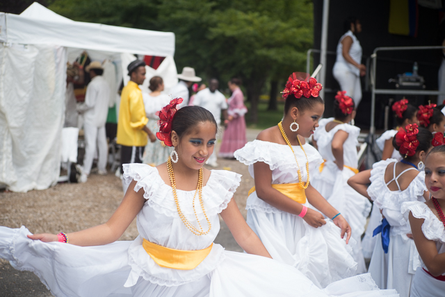 A child practices twirling before her performance during an event at Flushing Meadows Corona Park celebrating Colombian Independence Day.