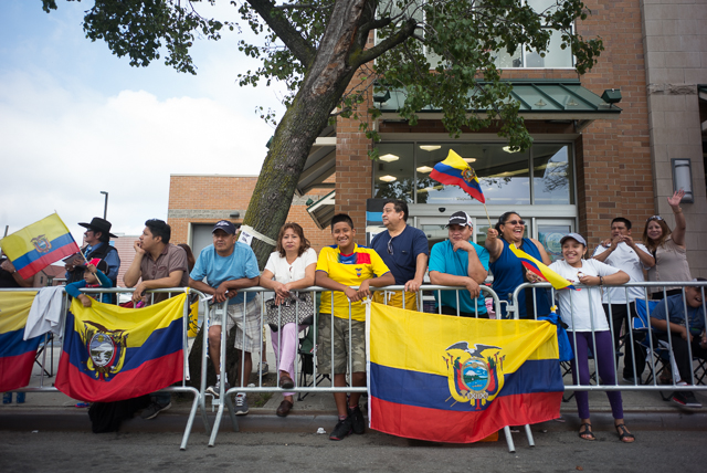 Spectators line the block at the Ecuadorian parade along Northern blvd. Sunday. Photo by Ken Maldonado