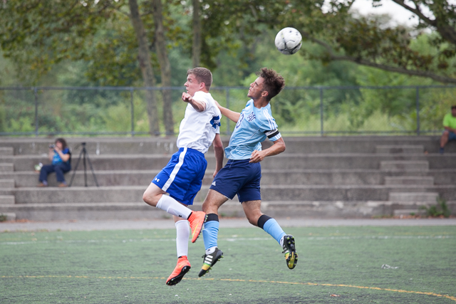 St. Francis Prep player Brian Kilcarr and Molloy player Pedro Paula make a jump for the ball.