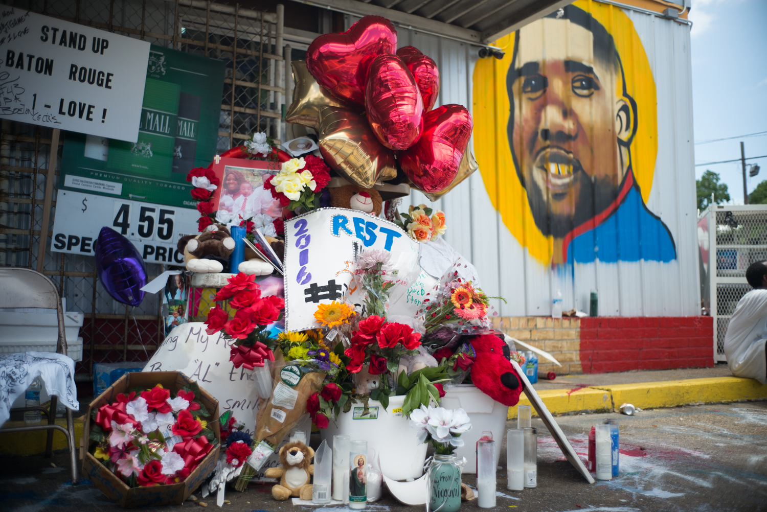 A memorial builds from items left behind by friends, family and the citizens of Baton Rouge at the site where Alton Sterling, 37, was shot and killed by a police officer after a homeless man called in a complaint that Sterling had brandished a gun after asking him for money. Sterling had been selling CD's outside of the Triple S grocery store.